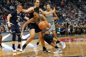Azura' Stevens drives past the defense. Photo by Stephen Slade.