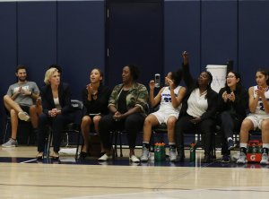 Vanessa Nygaard and assistant coach Ebony Hoffman, center, are in the second year coaching together. Photo by Maria Noble/WomensHoopsWorld.