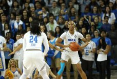 Lajahna Drummer prepares to pass to Japreece Dean. Photo by Maria Noble/WomensHoopsWorld.
