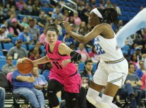 Robbi Ryan drives as Kennedy Burke defends. Photo by Maria Noble/WomensHoopsWorld.