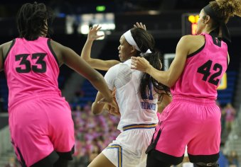 Lajahna Drummer maintains ball control. Photo by Maria Noble/WomensHoopsWorld.