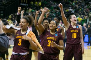 Gophers players celebrate their win over the Phoenix. Photo by Courtney Anderson.