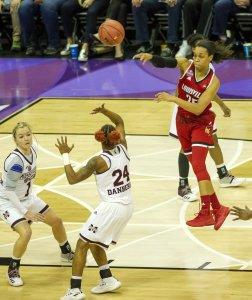 Asia Durr passes over Jordan Danberry. Photo by Jamie Thompson/T.G.Sportstv1.