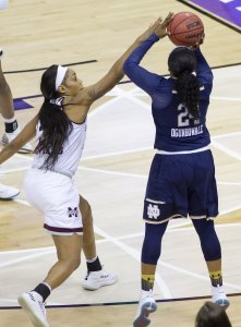 Arike Ogunbowale launches the game-winning shot for Notre Dame. Photo by Jamie Thompson/T.G.Sportstv1.