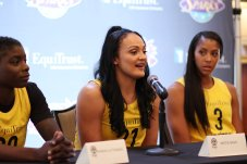 Mistie Bass speaks, flanked by Shakayla Thomas and Candace Parker. Photo by Maria Noble/WomensHoopsWorld.