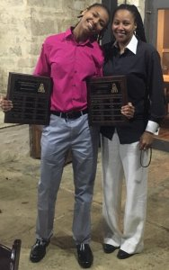 Shae Routt poses with mother Erica and two of her award plaques. Photo courtesy of Erica Routt.