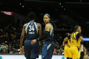 Sylvia Fowles and Maya Moore walk back to their side of the court. Maria Noble/WomensHoopsWorld.