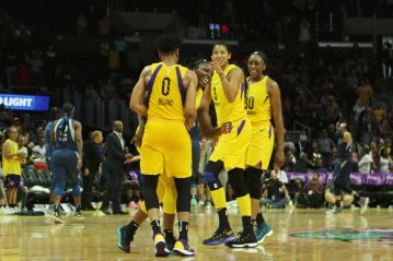 Alana Beard, Chelsea Gray, Candace Parker and Nneka Ogwumike laugh as time runs out on their win over the Lynx. Maria Noble/WomensHoopsWorld.
