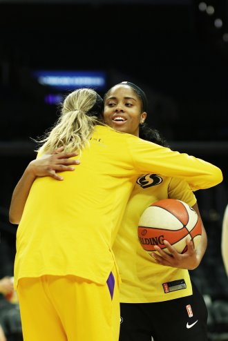 Former Pac-12 rivals Sydney Wiese and Jordin Canada embrace. Maria Noble/WomensHoopsWorld.