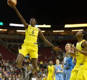 Natasha Howard takes flight. Neil Enns/Storm Photos.