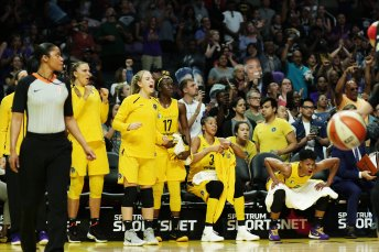 The Sparks bench is excited by play on the court. Maria Noble/WomensHoopsWorld.