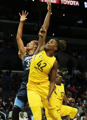 Angel McCoughtry and Jantel Lavender battle for a rebound. Maria Noble/WomensHoopsWorld.