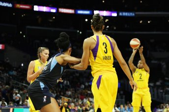 Riquna Williams launches a three-point shot attempt. Maria Noble/WomensHoopsWorld.
