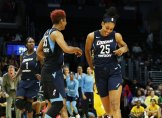 Dream court and bench players anticipate the win in the game's final minutes. Maria Noble/WomensHoopsWorld.