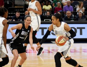 Maya Moore dribbles up court while Sue Bird defends her. Maggi Stivers/WomensHoopsWorld.