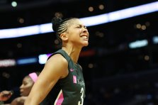 """Candace Parker is hyped after making the """"and-one"""" play. Maria Noble/WomensHoopsWorld."""