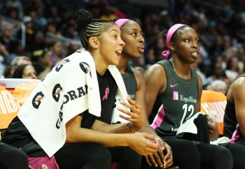Candace Parker, Nneka Ogwumike and Chelsea Gray watch the game's closing minutes. Maria Noble/WomensHoopsWorld.