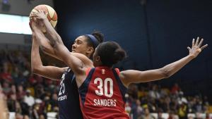 Monique Billings is fouled by LaToya Sanders in the first half. Nick Wass/Associated Press.