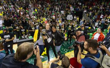 Crystal Langhorne, Breanna Stewart and Kaleena Mosqueda-Lewis pose with the trophy. Neil Enns/Storm Photos.