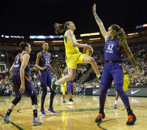 Breanna Stewart splits the Mercury defense and soars to the rim to score two of her 28 points on the night. Neil Enns/Storm Photos.