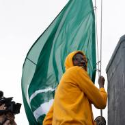 Natasha Howard hoists the flag. Neil Enns/Storm Photos.