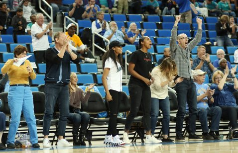 Jordin Canada and Kelli Hayes are exuberant as the Bruins pad their lead in the game's final minutes. Maria Noble/WomensHoopsWorld.