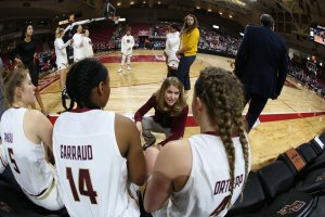 Coach Joanna Bernabei-McNamee talks to players before team introductions. Photo courtesy of Boston College Athletics.