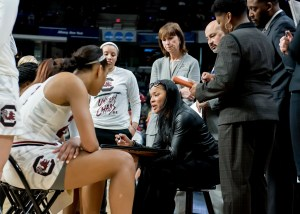 Dawn Staley conducts a timeout under the eye of Lisa Boyer. Photo courtesy of South Carolina Athletics.