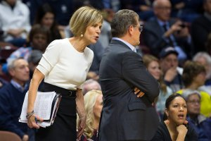 Chris Dailey talks to Geno Auriemma on the sidelines of a game. Photo courtesy of Connecticut Athletics.