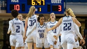 Players greet each other to start a timeout. Photo courtesy of Rice Athletics.