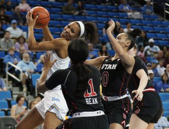 Lajahna Drummer is double-teamed. Maria Noble/WomensHoopsWorld.