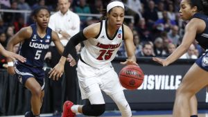 Asia Durr breaks through the Connecticut defense. Photo courtesy of Louisville Athletics.