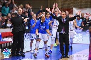 The Szekszard team celebrate a big win with their coaches. Photo courtesy of Szekszard.