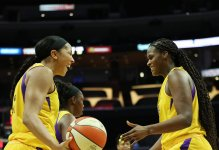 Candace Parker shares a moment with rookie Kalani Brown. Maria Noble/WomensHoopsWorld.