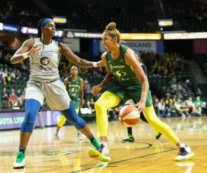 Mercedes Russell is defended by Sylvia Fowles. Neil Enns/Storm Photos.