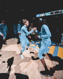 Courtney Vandersloot and Kahleah Copper perform their special handshake ritual before a game. NBAE/Getty Images via Chicago Sky.
