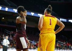 Ciera Johnson and Kayla Overbeck talk at a game pause. Maria Noble/WomensHoopsWorld