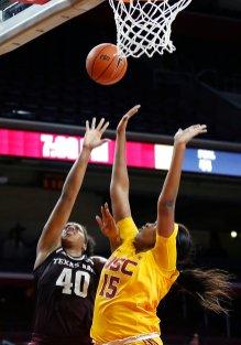 Ciera Johnson scores over her defender. Maria Noble/WomensHoopsWorld