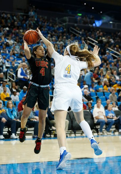 Endyia Rogers is defended by Lindsey Corsaro. Maria Noble/WomensHoopsWorld