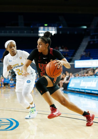 Desiree Caldwell races by Japreece Dean. Maria Noble/WomensHoopsWorld