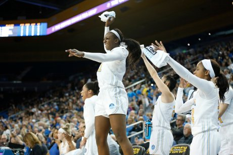 Michaela Onyenwere and her teammates celebrate a Bruin three-point shot. Maria Noble/WomensHoopsWorld