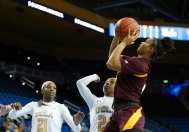 Reili Richardson shoots over the Bruin defense. Maria Noble/WomensHoopsWorld.