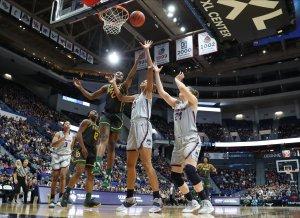 Queen Egbo defends the basket. David Butler II photo.