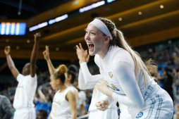 Lindsey Corsaro cheers from the bench. Maria Noble/WomensHoopsWorld.