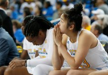 The Bruins are somber as they fall behind by 14 points in the second half. Maria Noble/WomensHoopsWorld.