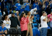 Jordin Canada and Kelli Hayes applaud the Bruin win. Maria Noble/WomensHoopsWorld.