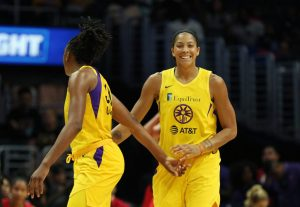 Candace Parker and Nneka Ogwumike celebrate a basket. Maria Noble/WomensHoopsWorld.