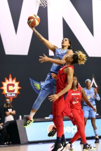 Gabby Williams drives over Aerial Powers to score. Photo by Ned Dishman/NBAE via Getty Images.