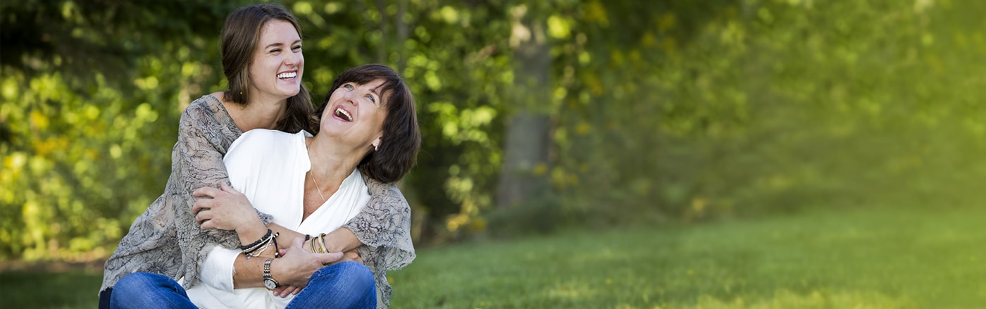 Mother and daughter laughing in the park