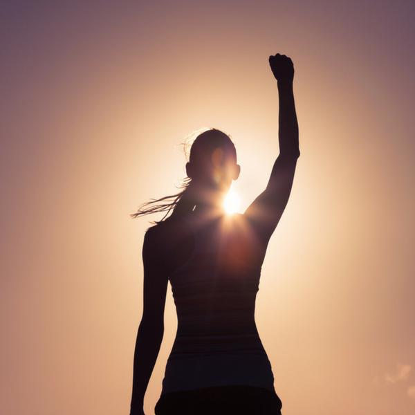 Women in front of sun